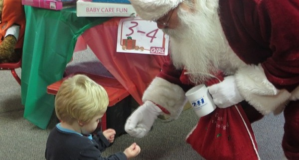 Santa Helps Hearts & Lives Distribute Toys To 343 Children