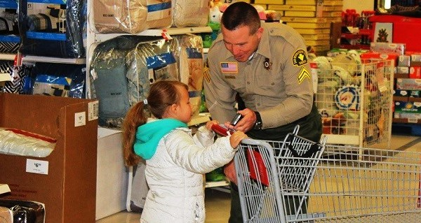 32 Youngsters Shop With A Cop at K-Mart