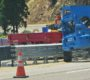 HIGHWAY 18: Thrie-Beam Median Barrier About 85 Percent Completed